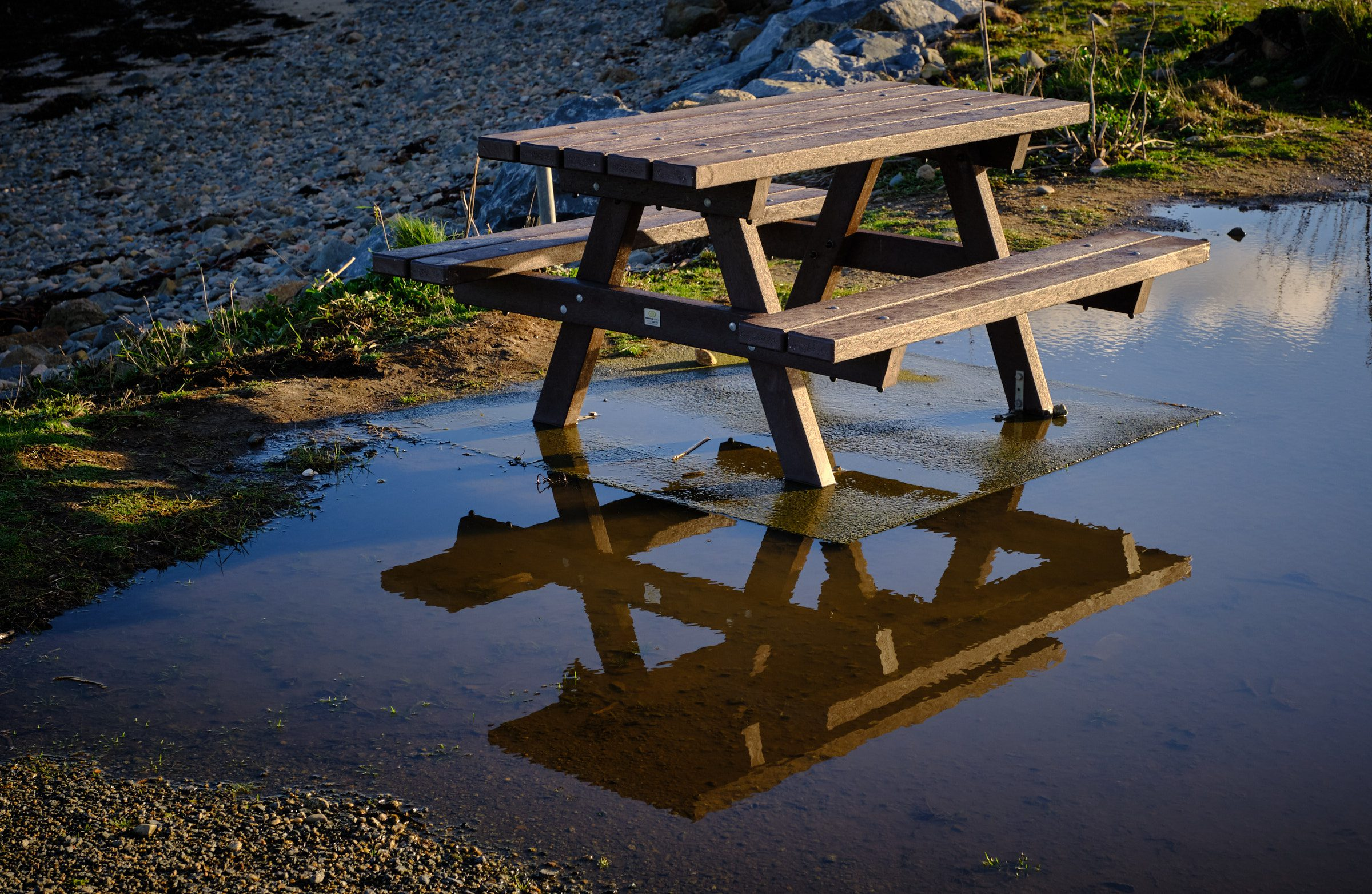 Picnic bench in puddle